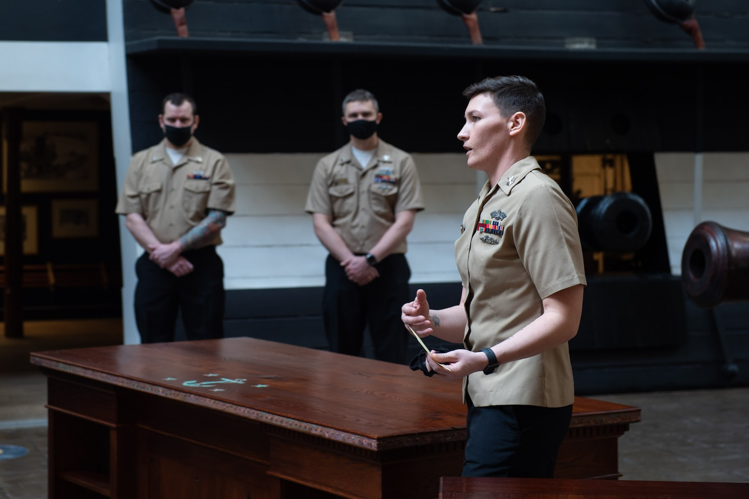 Builder 1st Class Hilary Lemelin, gives a speech during an executive desk presentation event at the National Museum of the U.S. Navy.