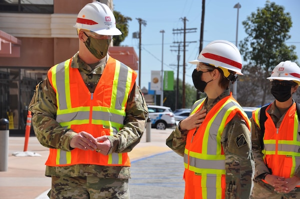 Col. Julie Balten, commander of the U.S. Army Corps of Engineers Los Angeles District, right, and Brig. Gen. Paul Owen, commander of the Corps' South Pacific Division, left, pause for a quick discussion March 19 after viewing construction progress of the Corps and its contractors work on an alternate care facility at Adventist Health White Memorial Medical Center in the Boyle Heights neighborhood of Los Angeles.