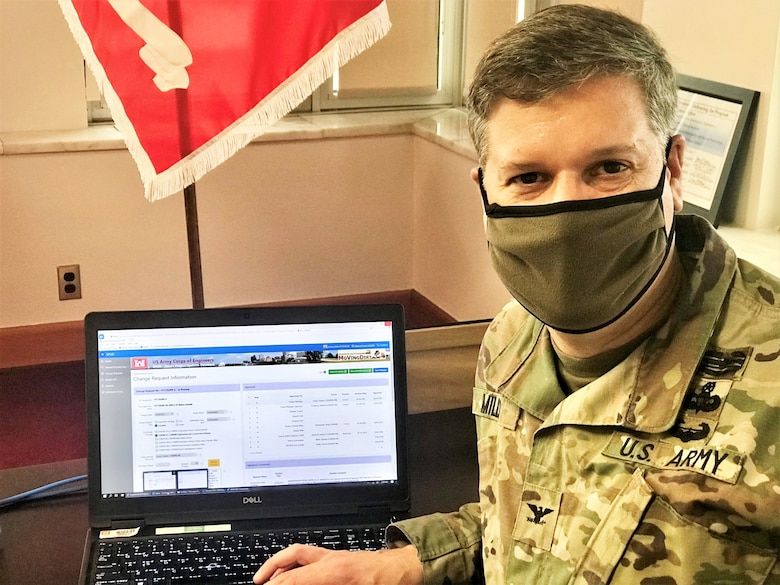 Memphis District Commander Col. Zachary Miller signs the first SPOT Report using the new Smart Project Updates Dashboard.