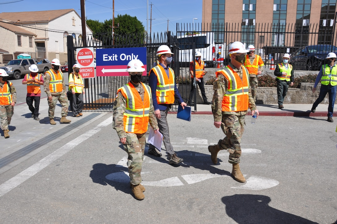 Col. Julie Balten, commander of the U.S. Army Corps of Engineers Los Angeles District, left; David Van Dorpe, deputy district engineer for the Corps' LA District, center; and Brig. Gen. Paul Owen, commander of the Corps' South Pacific Division, right, arrive at Adventist Health White Memorial Medical Center March 19 to view construction progress on an alternate care facility the Corps and its contractors built in support of FEMA and in coordination with the State of California in its response to the COVID-19 pandemic.