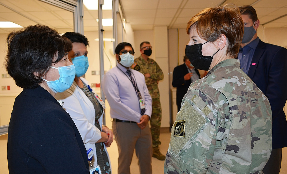 Col. Julie Balten, commander of the U.S. Army Corps of Engineers Los Angeles District, right, talks to Alice Cheng, president and CEO of Beverly Community Hospital, left, during a March 19 project site tour of the hospital in Montebello, California. The Corps and its contractors converted the hospital's west wing into a 17-room, NON-COVID patient area and the hospital's day care waiting room into a COVID patient staging area, by adding high-flow oxygen and converting the area to negative pressure. The final inspection of the construction work at the hospital was completed earlier that morning.