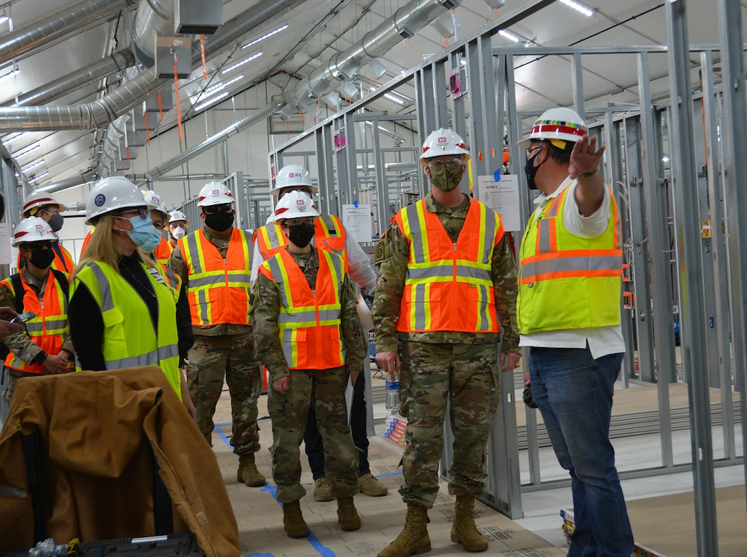 Jeremy Ayala, contracting officer representative for the U.S. Army Corps of Engineers Omaha District, center right, briefs Brig. Gen. Paul Owen, commander of the Corps' South Pacific Division, second from right, and Col. Julie Balten, commander of the Corps' Los Angeles District, center, March 19 about the Corps and its contractors' construction progress on an alternate care facility at Adventist Health White Memorial Medical Center in the Boyle Heights neighborhood in Los Angeles.