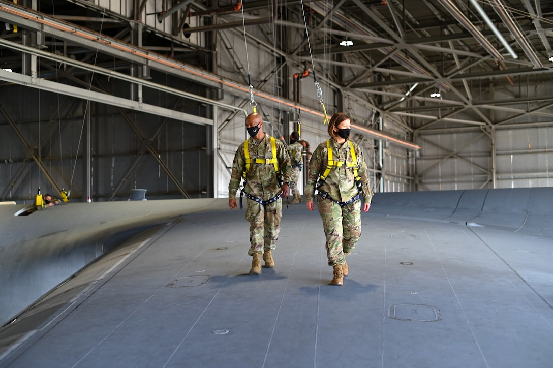 Chief Master Sergeant Mike Perry, Air Force first sergeant special duty manager, and Chief Master Sergeant of the Air Force JoAnne S. Bass, walk on the wing of a C-5M Super Galaxy March 25, 2021, at Travis Air Force Base, Calif. Bass visited Travis AFB to meet the Airmen who demonstrate innovative thinking and enhance the rapid global mobility mission.