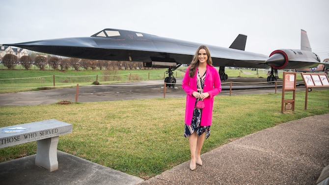 Camille Schrier, Miss America 2020, poses for a photo in front of an SR-71 Blackbird static display at the Global Power Museum at Barksdale Air Force Base, Louisiana, March 24, 2021.