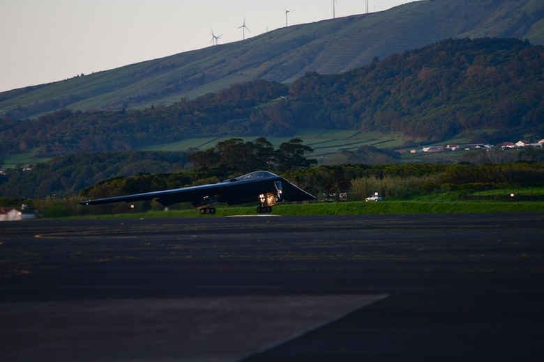 A B-2 Spirit stealth bomber, assigned to Whiteman Air Force Base, Missouri, departs Lajes Field, Azores, March 25, 2021. The strategic bomber missions provide Airmen an opportunity to test their rapid response capability, allowing them to meet any potential crisis or challenge across the globe. (U.S. Air Force photo by Tech. Sgt. Heather Salazar)