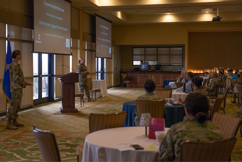 U.S. Air Force Chief Master Sgt. Sarah Esparza, 81st Training Wing command chief, speaks to attendees during the Military Women's Summit in the Bay Breeze Event Center at Keesler Air Force Base Mississippi, March 26, 2021. The summit focused on owning leadership catered to veterans, retirees, reservists, active duty and national guard members. (U.S. Air Force photo by Senior Airman Kimberly L. Mueller)