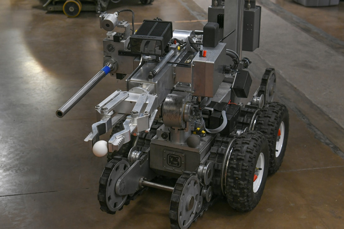 A 7th Civil Engineer Squadron explosive ordinance disposal F6 robot carries an egg at Dyess Air Force Base, Texas, Feb. 8, 2021. When doing the egg test, the driver must be slow and careful with movements to prevent breaking or dropping the egg. (U.S. Air Force photo by Airman 1st Class Josiah Brown)