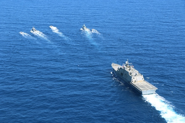 The Freedom-variant littoral combat ship USS Wichita (LCS 13) conducts a bi-lateral maritime exercise with naval counterparts from the Dominican Republic, March 24, 2021.