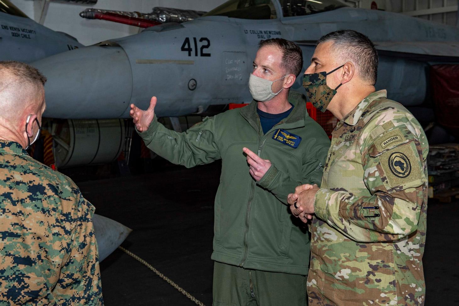Gen. Stephen Townsend, Commander, United States Africa Command, observes flight operations aboard the Nimitz-class aircraft carrier USS Dwight D. Eisenhower (CVN 69), in the Mediterranean Sea, March 25, 2021.