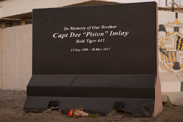 """Flowers lay at a memorial honoring U.S. Air Force Capt. Dee """"Piston"""" Imlay, 391st Fighter Squadron F-15 pilot, at Al Dhafra Air Base, United Arab Emirates, March 28, 2021."""