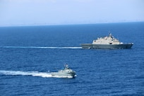 The Freedom-variant littoral combat ship USS Wichita (LCS 13) and the Dominican Republic Coastal Patrol Vessel Orion (GC 109) conduct a bi-lateral maritime exercise, March 24, 2021.