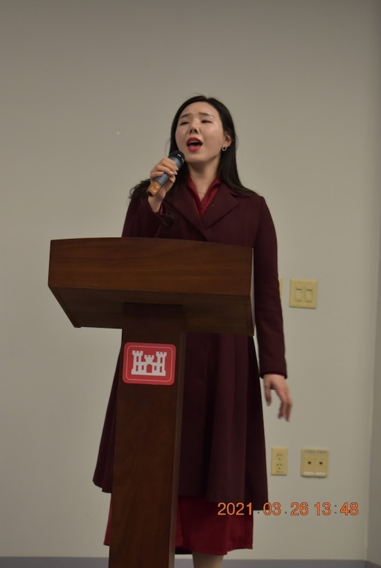 Eman Sundquist, Programs and Project Management Division (PPMD) project manager, speaks to the crowd of attendees about finding her place in a world made for men during the Far East District's Women's History Month celebration at District Headquarters, USAG Humphreys, Republic of Korea, Mar. 26, 2021. The event centered on a panel of FED women, who spoke about their experiences as women in the workforce.