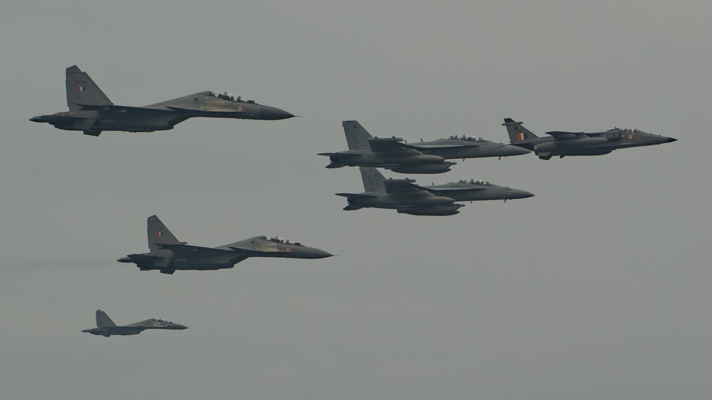"INDIAN OCEAN (March 28, 2021) – Two EA-18G Growlers, assigned to the ""Gray Wolves"" of Electronic Attack Squadron (VAQ) 142, fly in formation with an Indian Air Force Jaguar and two Su-30MKIs over the aircraft carrier USS Theodore Roosevelt (CVN 71) March 28, 2021. The Theodore Roosevelt Carrier Strike Group is on a scheduled deployment to the U.S. 7th Fleet area of operations. As the U.S. Navy's largest forward-deployed fleet, 7th Fleet routinely operates and interacts with 35 maritime nations while conducting missions to preserve and protect a free and open Indo-Pacific Region. (U.S. Navy photo by Mass Communication Specialist 2nd Class Zachary Wheeler)"