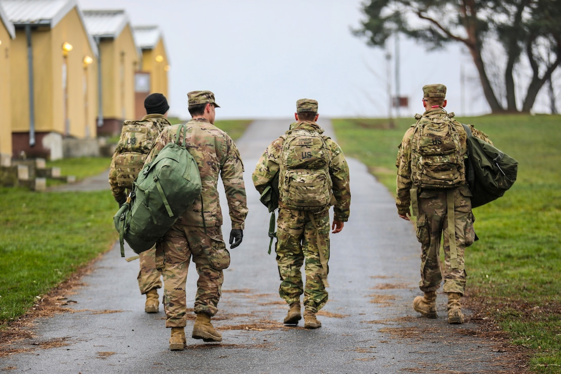 U.S. Army Soldiers from the 91st Brigade Engineer Battalion, 1st Armored Brigade Combat Team, 1st Cavalry Division carry their duffel bags to their temporary barracks at Camp Aachen in Grafenwoehr, Germany, Dec. 19, 2018. This is the last stop of 1-1 CD's rotation supporting Atlantic Resolve, an exercise to improve the interoperability of U.S. Forces with their NATO allies and partners. Walkability and a proximity to the barracks are important factors in siting the Operational Readiness Training Center in the Grafenwoehr Training Area's Area Development Execution Plan.