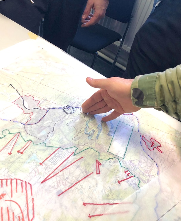 Soldiers and Civilian personnel discuss possible future plans for sections of the Grafenwoehr Training Area during collaboration sessions in spring 2019 that were part of creating an Area Development Execution Plan to outline the long-term plan for the area.