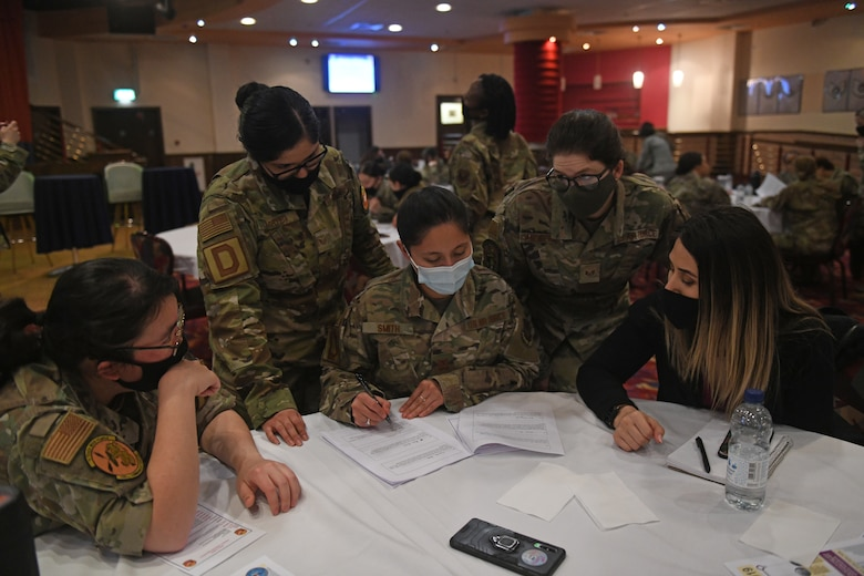 Tri-Base Women's Leadership Symposium attendees complete a historical trivia questionnaire during a team-building activity at Royal Air Force Mildenhall, England, March 24, 2021. The event aimed to provide women across the tri-base area the opportunity to network and empower one another through open discussion and leadership development. (U.S. Air Force photo by Staff Sgt. Mackenzie Mendez)