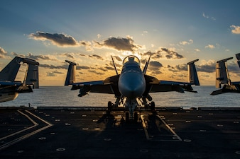 An F/A-18E Super Hornet sits on the flight deck aboard USS Dwight D. Eisenhower (CVN 69) in the Mediterranean Sea.