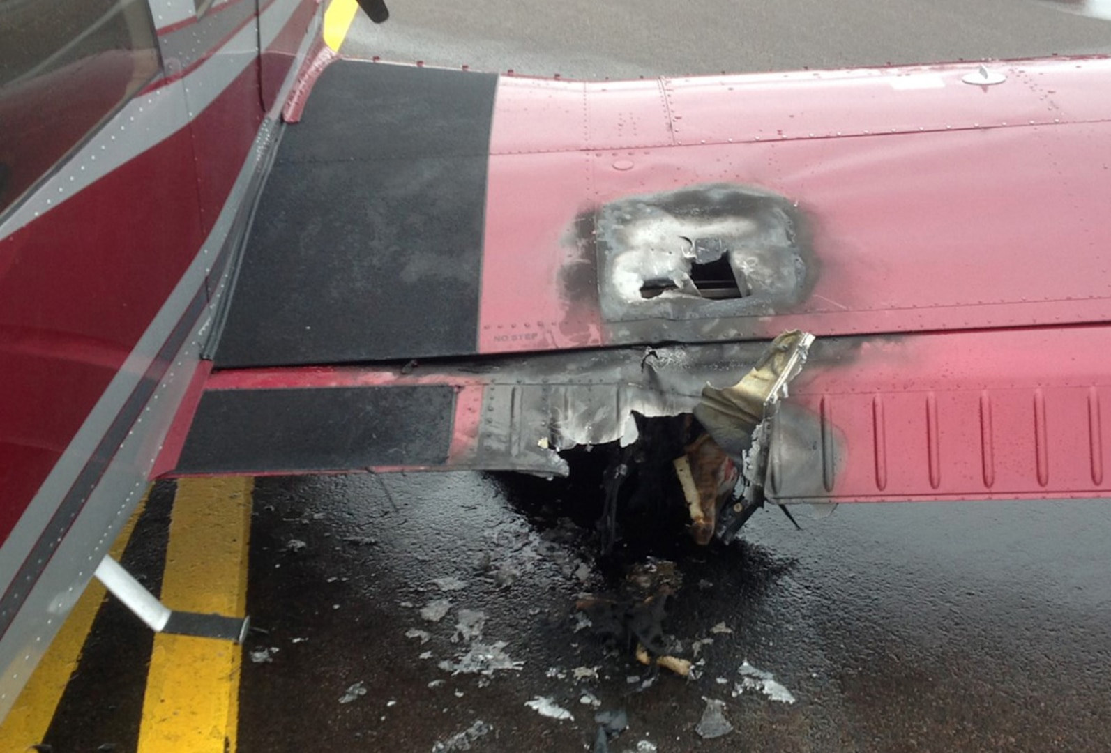 A photo taken in the aftermath of the 158th Fighter Wing Fire Department's response to an aircraft fire shows damage to the aircraft's fuselage. (courtesy photo)