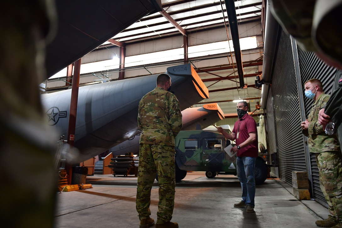 Airman receives overview of fuselage trainer.