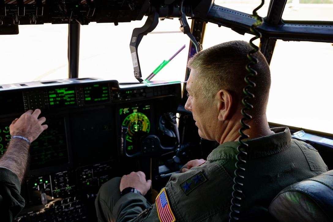 Airmen conduct pre-flight checks on a C-130J Super Hercules.