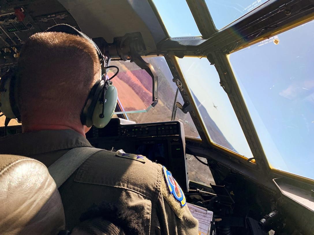 An Airman flies a C-130J Super Hercules.