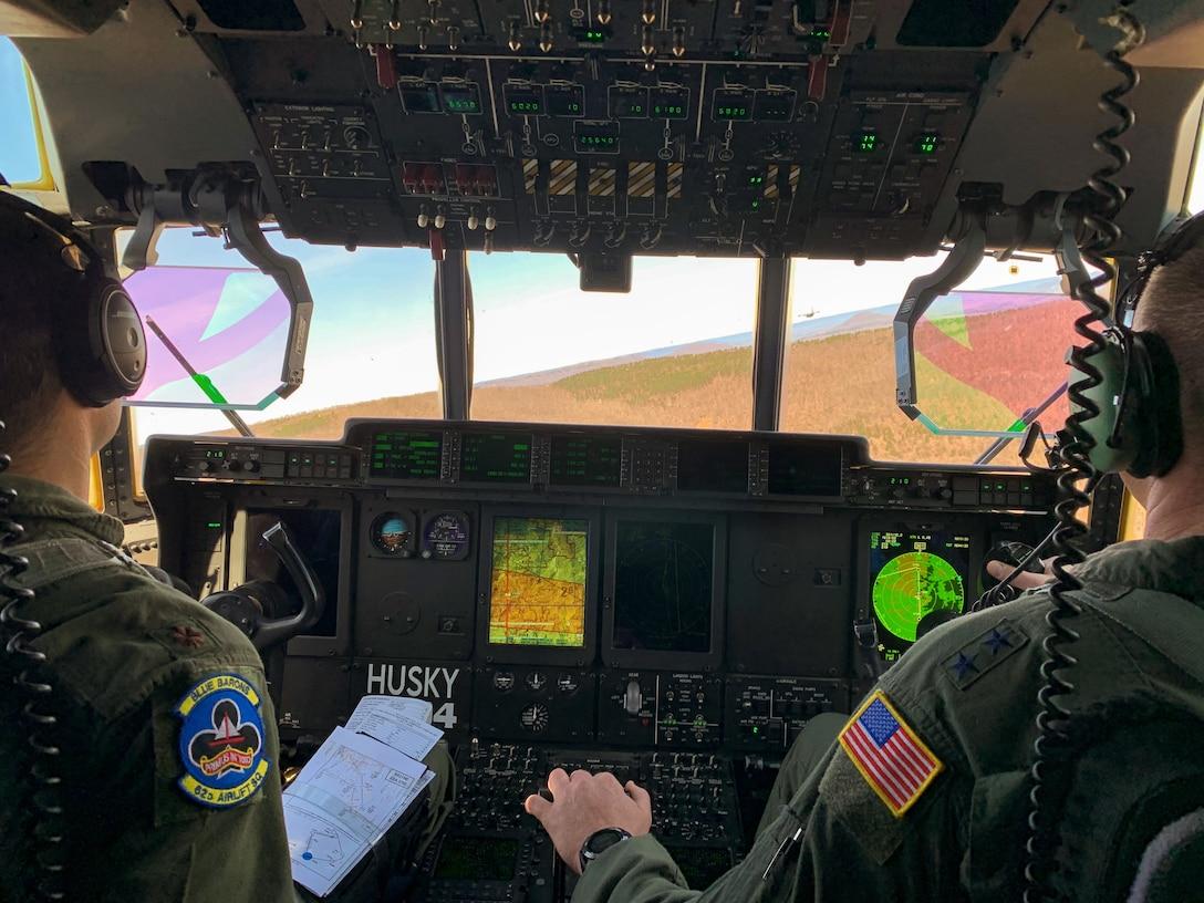 Airmen fly a C-130J Super Hercules