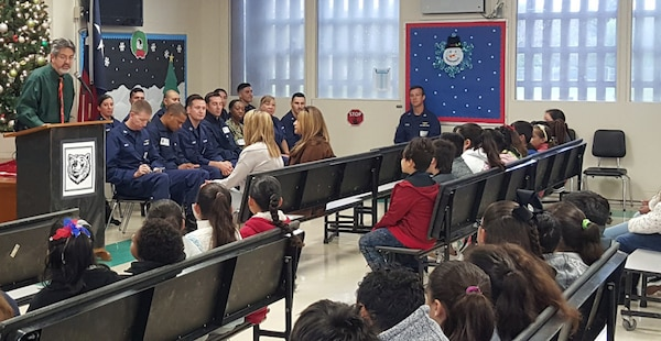Faculty, staff, and students from Gibson Elementary School welcome PIE program volunteers and coordinators of Sector/Air Station Corpus Christi, Texas during the PIE Kickoff event in December 2019. Lt. Mark Currier played a pivotal role in bringing the PIE program to Gibson Elementary School.