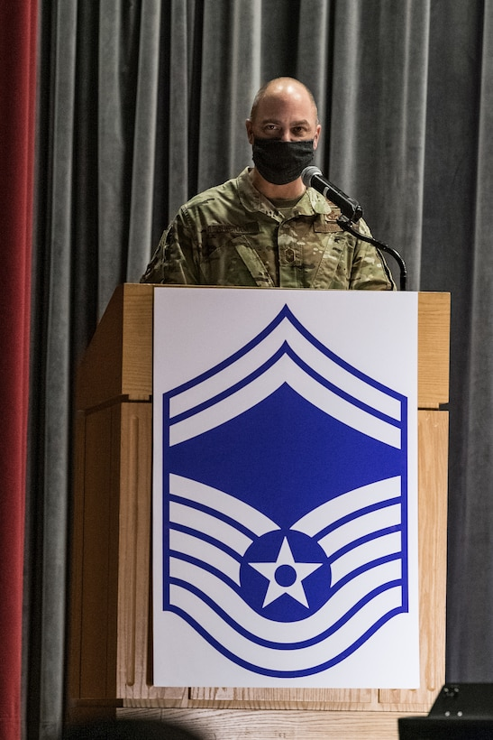 Chief Master Sgt. Jeremiah Grisham, 436th Airlift Wing interim command chief, makes opening remarks during the senior master sergeant promotion release ceremony held at the base theater on Dover Air Force Base, Delaware, March 26, 2021. Ten master sergeants at Dover AFB were selected for promotion to senior master sergeant in the 21E8 promotion cycle. (U.S. Air Force photo by Roland Balik)