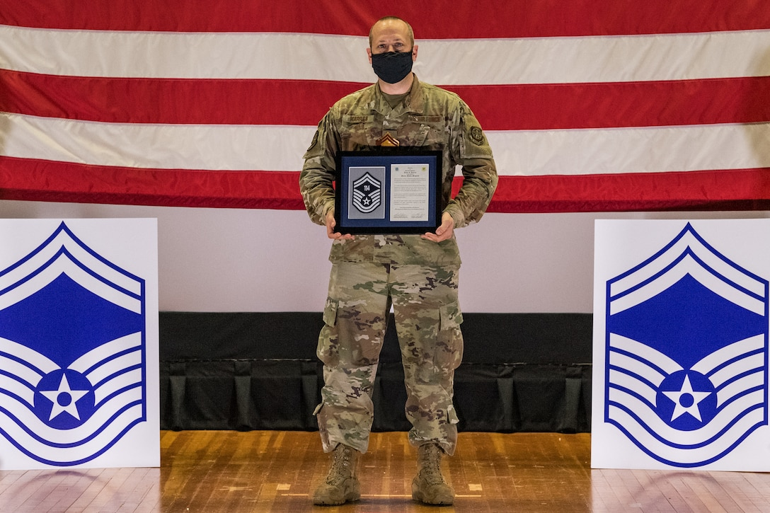 Master Sgt. Jason Karras, 436th Logistics Readiness Squadron fuels management flight superintendent, poses for a photo during the senior master sergeant promotion release ceremony held at the base theater on Dover Air Force Base, Delaware, March 26, 2021. Karras was one of 10 master sergeants at Dover AFB selected for promotion to senior master sergeant in the 21E8 promotion cycle. (U.S. Air Force photo by Roland Balik)
