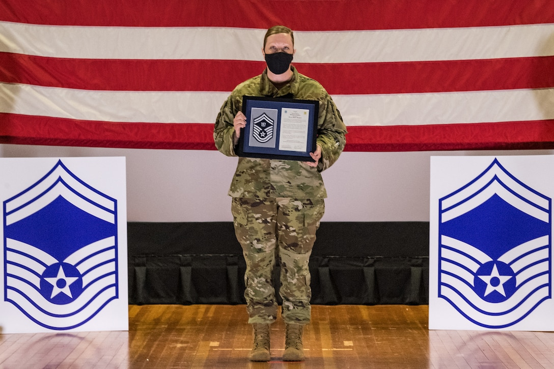 Master Sgt. Marilyn Landers, 436th Logistics Readiness Squadron individual protection equipment section chief, poses for a photo during the senior master sergeant promotion release ceremony held at the base theater on Dover Air Force Base, Delaware, March 26, 2021. Landers was one of 10 master sergeants at Dover AFB selected for promotion to senior master sergeant in the 21E8 promotion cycle. (U.S. Air Force photo by Roland Balik)
