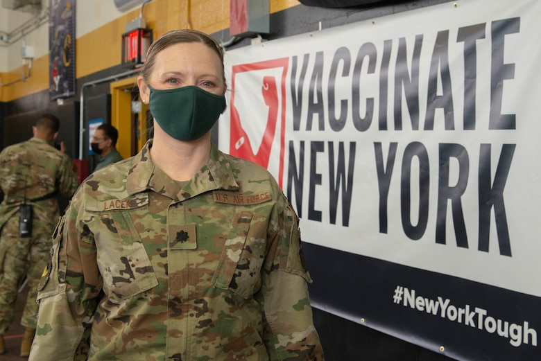 Lt. Col. Angela Lacek, a Port Huron, Mich., native and the 335th Expeditionary Medical Operations Squadron chief nurse, takes a quick break from her duties providing vaccinations at the state-led, federally supported Medgar Evers College Community Vaccination Center in Brooklyn, N.Y., March 22, 2021. Lacek is deployed from the 42nd Medical Group out of Maxwell Air Force Base, Ala., and is one of approximately 140 Airmen across 28 installations deployed to the Medgar Evers College CVC in support of U.S. Army North's COVID-19 response efforts. (U.S. Air Force photo by Tech. Sgt. Ashley Nicole Taylor)