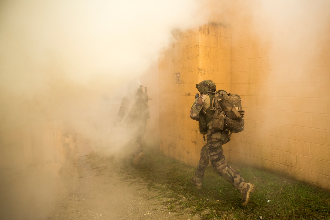 Members of the French Foreign Legion conduct urban operations as part of Exercise Bold Alligator 17 at Military Operations in Urban Terrain Town on Camp Lejeune, N.C., Oct. 29, 2017. Bold Alligator 17 is a large scale, multinational amphibious exercise designed to execute complex shaping operations, amphibious landing and attack, and sea basing operations to improve U.S. and coalition ship-to-shore capabilities. (U.S. Marine Corps photo by Cpl. Abraham Lopez)