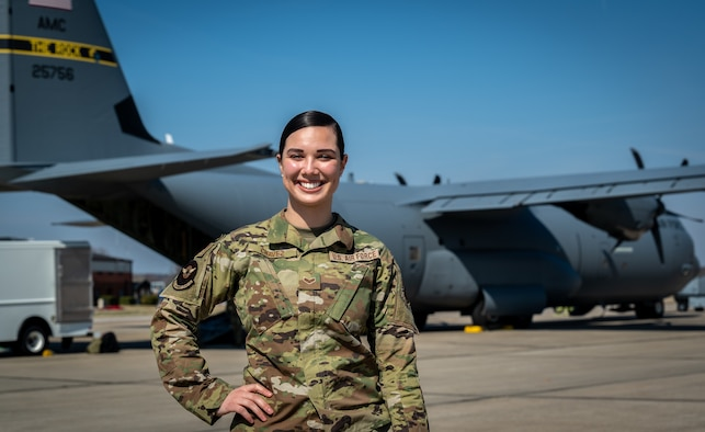 Senior Airman Giovanna Chavez, 932nd Aeromedical Evacuation Squadron technician, poses with a C-130 as a backdrop March 7, 2021, Scott Air Force Base, Illinois.  Chavez was a recent Airman Spotlight and shared her Air Force story with 932nd Airlift Wing leadership during a Wing leadership meeting. (U.S. Air Force photo by Christopher Parr)