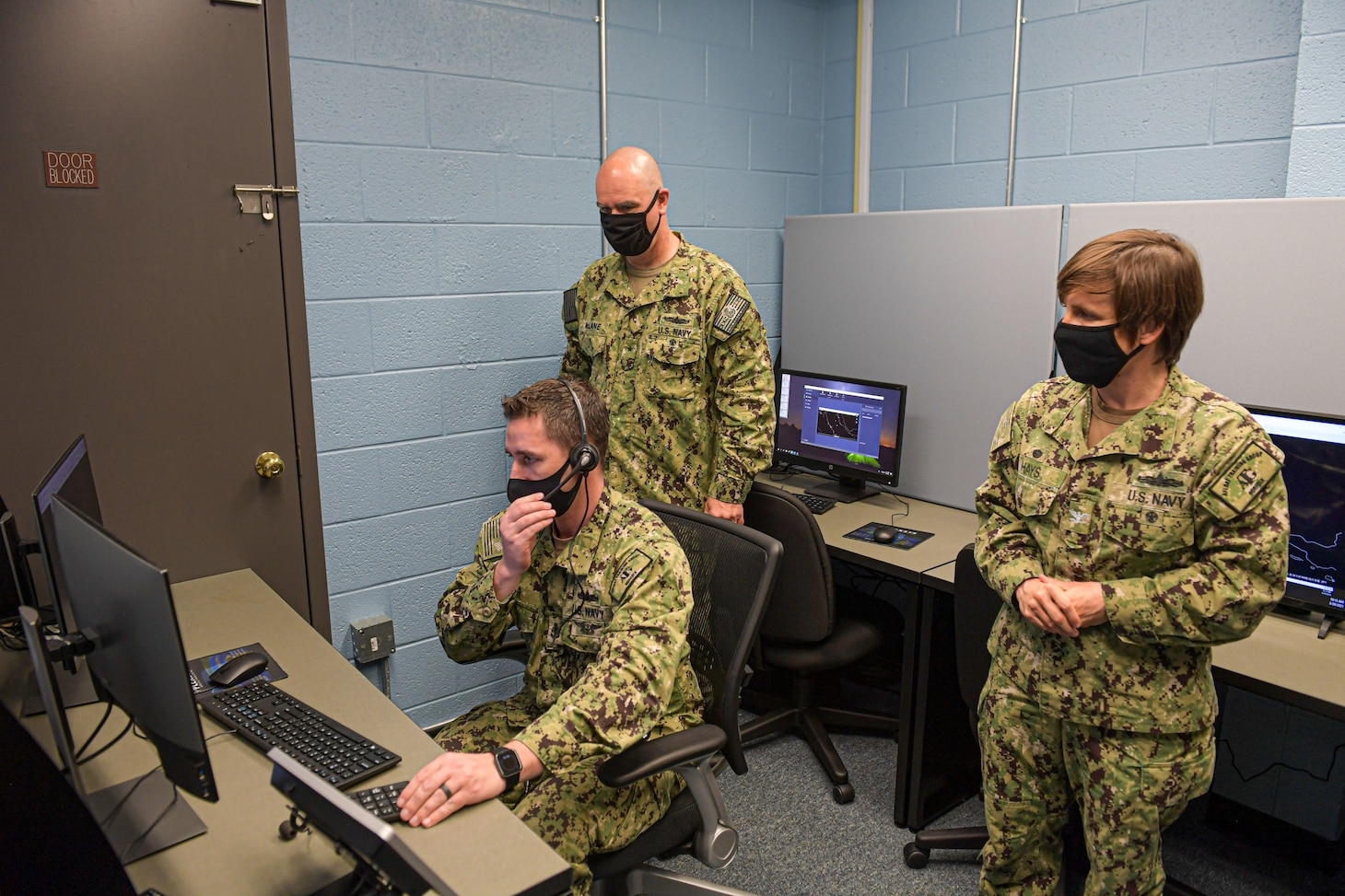 Rear Adm. Brendan McLane, commander, Naval Surface Force Atlantic, tours the new Air Intercept Controller (AIC) training lab with Senior Chief Operations Specialist Adam Siler, Afloat Training Group (ATG) Norfolk�s AIC supervisor and Capt. Mary Hays, ATG Norfolk�s commanding officer. Along with training AICs, the lab will also open training events to shipboard anti-air warfare coordinators (AAWC) to promote AIC/AAWC integration. (U.S. Navy photo by Mass Communication Specialist 2nd Class Jacob Milham/RELEASED)