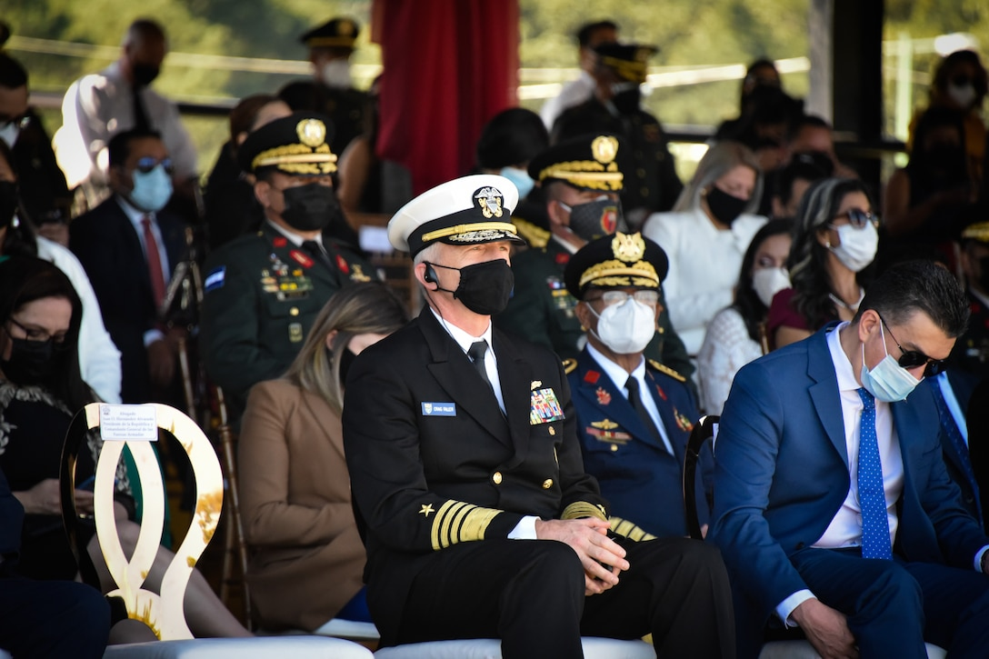 Navy admiral sits with partner nation military leaders.