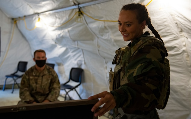 U.S. Air Force Airman 1st Class Maria Daneault, an emergency management apprentice assigned to the 36th Civil Engineer Squadron, instructs a student on Chemical, Biological, Radiological, Nuclear and Explosives defense training at Andersen Air Force Base, Guam, March 25, 2021.