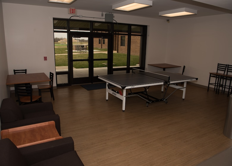 The dayroom in Endeavour Hall contains a ping pong table along with seating and vending machines for Airmen to use.