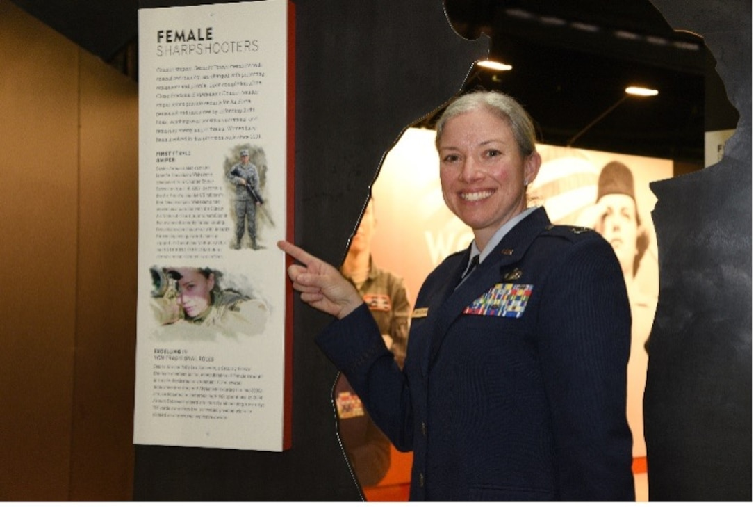 Illinois Air National Guard Capt. Jennifer Weitekamp, the first female sniper in the U.S. military, is among Air Force women featured in an exhibit at the National Museum of the U.S. Air Force at Wright-Patterson Air Force Base near Dayton, Ohio. Weitekamp is shown next to the Women in the Air Force exhibit March 5, 2021.