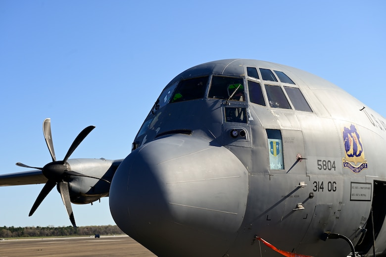 A C-130J Super Hercules rests on the flight line