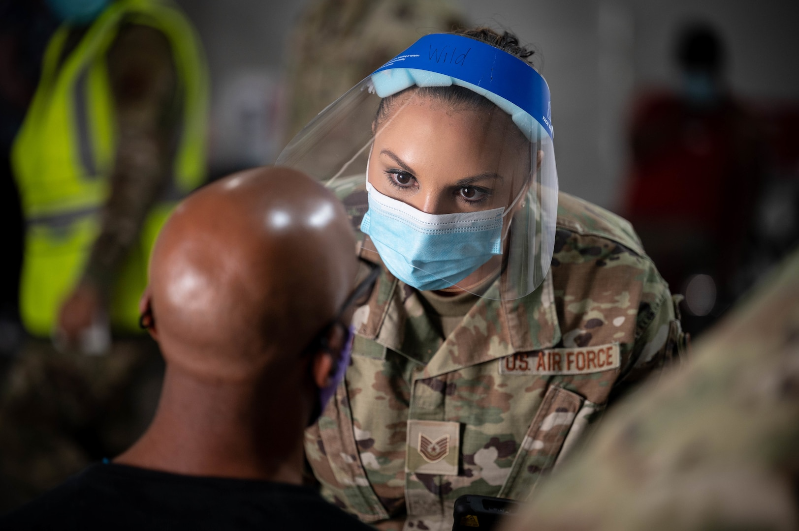 U.S. Air Force Airman 1st. Class Linzie Avalos, deployed from Peterson Air Force Base, Colorado, prepares to vaccinate a Tampa community member at the Tampa Community Vaccination Center March 12, 2021 in Tampa, Florida. Avalos is one of nearly 140 Airmen on site at the state-led, federally-supported operation. U.S. Northern Command, through U.S. Army North, remains committed to providing continued, flexible Department of Defense support to the Federal Emergency Management Agency as part of the whole-of-government response to COVID-19. (U.S. Air Force photo by Master Sgt. Holly Roberts-Davis/Luke AFB Public Affairs)