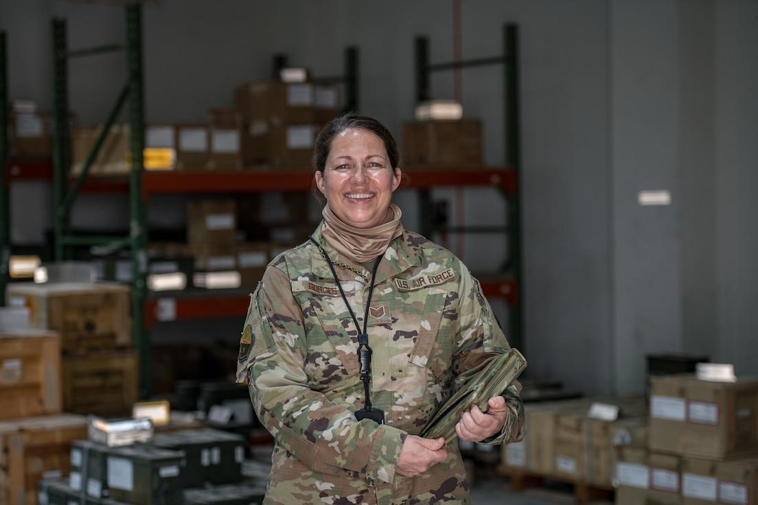 a woman poses for a portrait in uniform