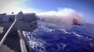 USS John S. McCain (DDG 56) launches a recoverable exercise torpedo during an anti-submarine warfare exercise.