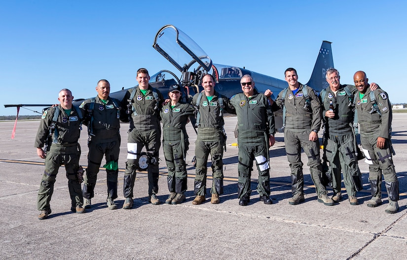 Air Force T-38 pilots assigned to the 560th Flying Training Squadron pose for a group photo with Capt. Gregg Hanson, Maj. Richard Bates and Janine Sijan after receiving their freedom flight at Joint Base San Antonio-Randolph March 25. The Freedom Flyer Reunion is an annual celebration recognizing the service of Air Force Prisoners of War during the Vietnam War.