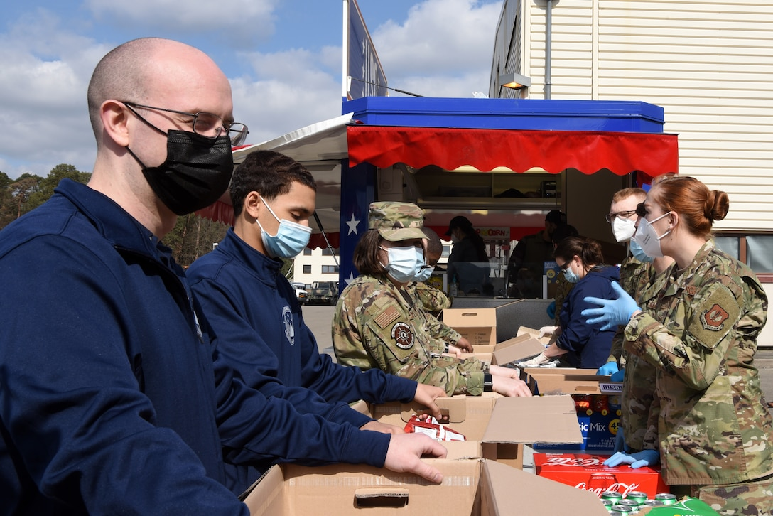 U.S. Air Force Airmen assigned to the 86th Vehicle Readiness Squadron, right, fill boxes with lunches for fellow 86th Logistics Readiness Group Airmen on the VRS compound.