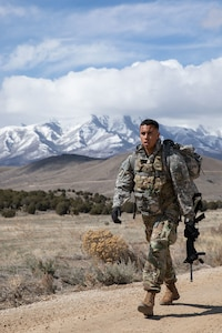 soldier marches with a ruck sack
