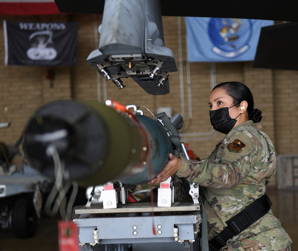 Staff Sgt. Cindy Guillen, 56th Component Maintenance Squadron weapons load technician, loads a GBU-12 Paveway II laser-guided bomb on an F-35A Lightning II during an exhibition load March 25, 2021, at Luke Air Force Base, Arizona. Guillen spoke about participating in the load to bring attention to the fact that only three women from her career field have made it to the rank of chief master sergeant since the inception of the Air Force. Diversity allows the Air Force to capitalize on all available talent by enabling a culture of inclusion. (U.S. Air Force photo by Staff Sgt. Amber Carter)