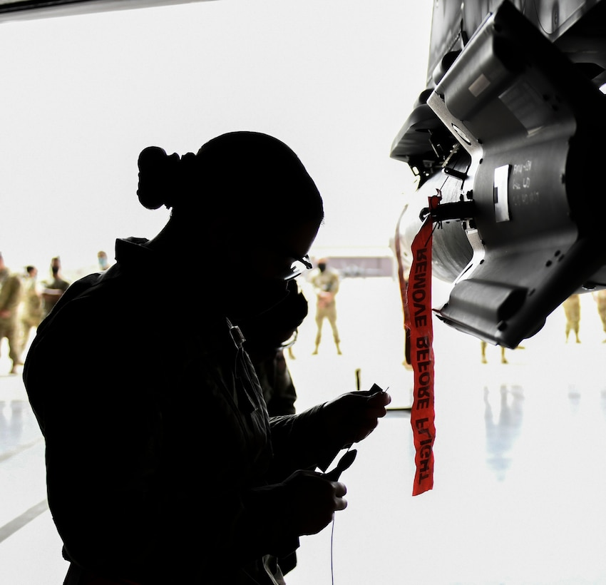 Airman 1st Class Melanie Morgan, 63rd Aircraft Maintenance Unit weapons load technician, prepares to install the guidance section of a GBU-12 Paveway II laser-guided bomb March 25, 2021, at Luke Air Force Base, Arizona. Morgan was part of a three-person team made of female Airmen from different units during the Women of Weapons Exhibition Load, which highlighted the capabilities of women in the weapons load careerfield. Diversity allows the Air Force to capitalize on all available talent by enabling a culture of inclusion. (U.S. Air Force photo by Staff Sgt. Amber Carter)