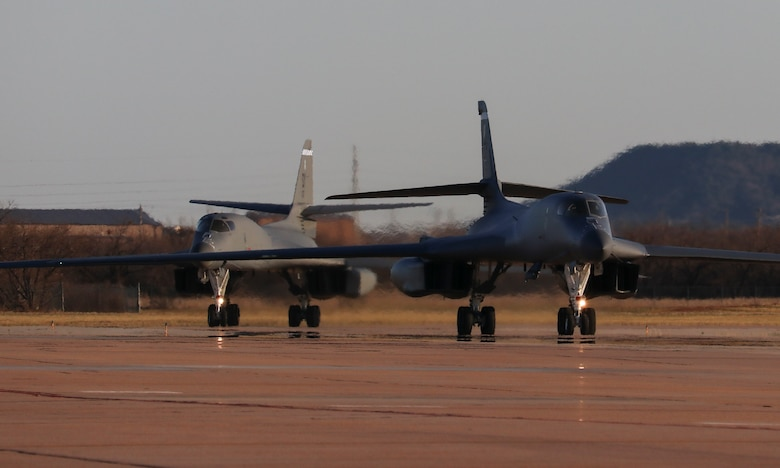 Two B-1B Lancers assigned to the 9th Expeditionary Bomb Squadron taxi on the flightline after returning from a Bomber Task Force Europe deployment in Norway at Dyess Air Force Base, Texas, March 23, 2021. The B-1B aircraft is a highly-versatile, supersonic, multi-mission weapon system that carries the largest payload of both guided and unguided weapons in the U.S. Air Force inventory. (U.S. Air Force photo by Staff Sgt. David Owsianka)