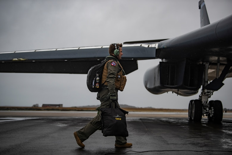 A pilot assigned to the 9th Expeditionary Bomb Squadron steps toward a B-1B Lancer at Ørland Air Force Station, Norway, March 23, 2021. During the Bomber Task Force Europe deployment, the 9th EBS successfully integrated with 11 NATO ally and partner nations. (U.S. Air Force photo by Airman 1st Class Colin Hollowell)