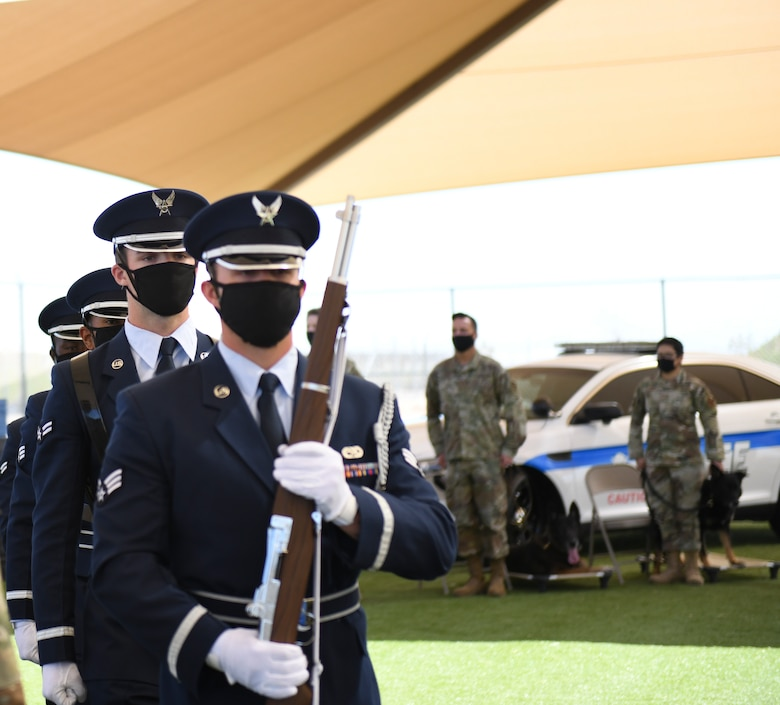 Airmen from the  56th Fighter Wing Honor Guard post the colors at a military working dog retirement ceremony March 19, 2021, at Luke Air Force Base, Arizona. Boss and Rango, 56th Security Forces Squadron military working dogs, retired after seven and eight years of service, respectively. As the Air Force prepares to retire a MWD, the dog's handler can request to adopt the dog enabling it to live the remainder of its life as a family member. Boss and Rango will retire and live at home with their respective handler. (U.S. Air Force photo by Staff Sgt. Amber Carter)